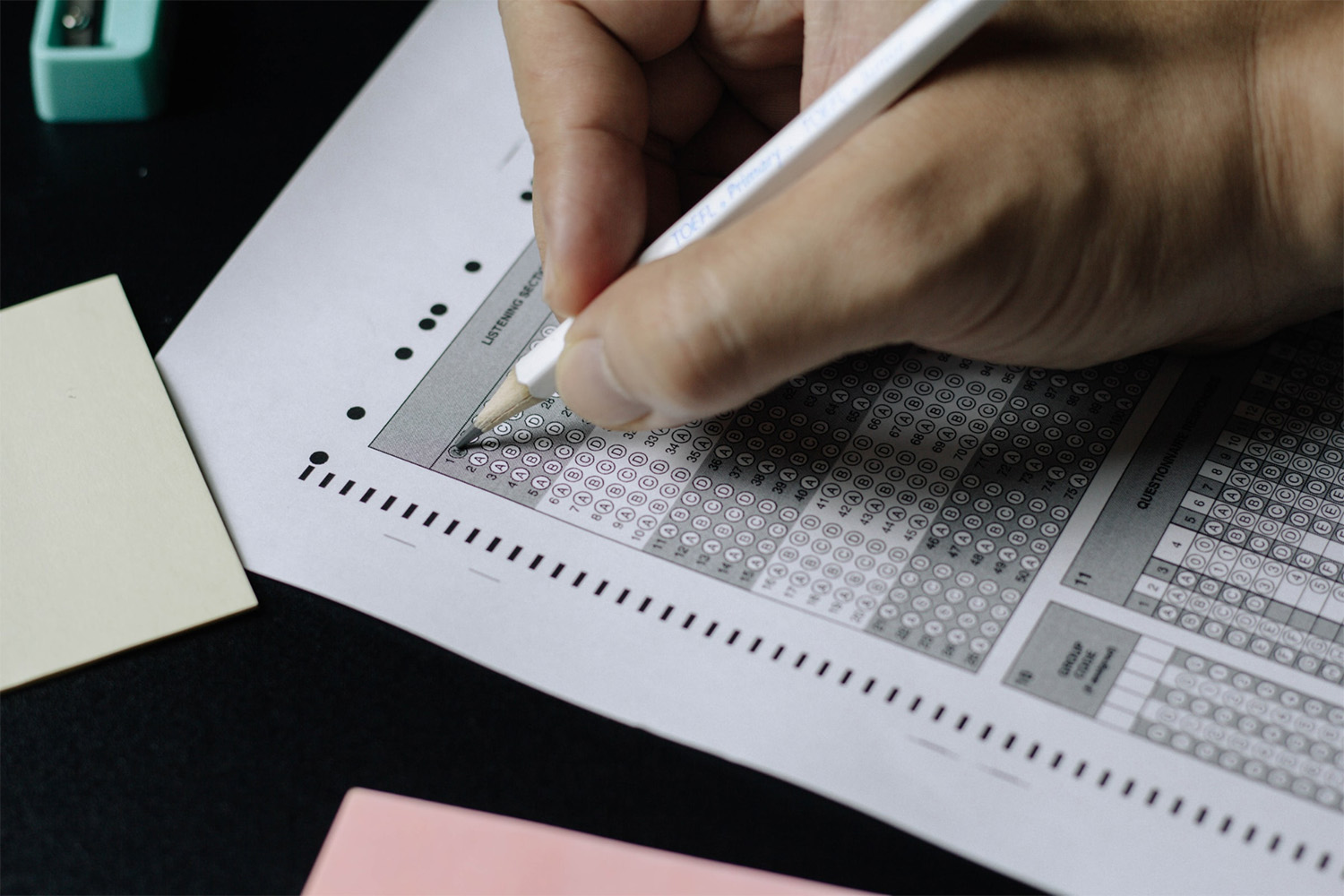 Student filling out a multiple choice exam