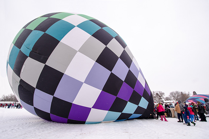 People inflating a hot air balloon