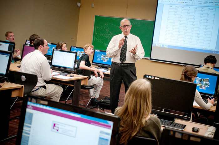An instructor lecturing in a computer lab