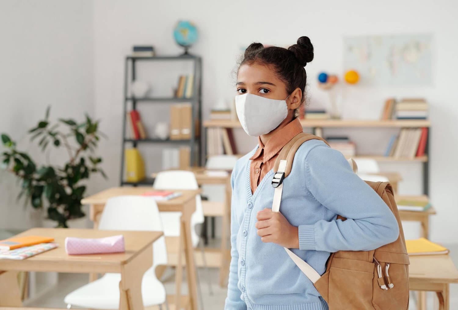 Student in a classroom wearing a face mask