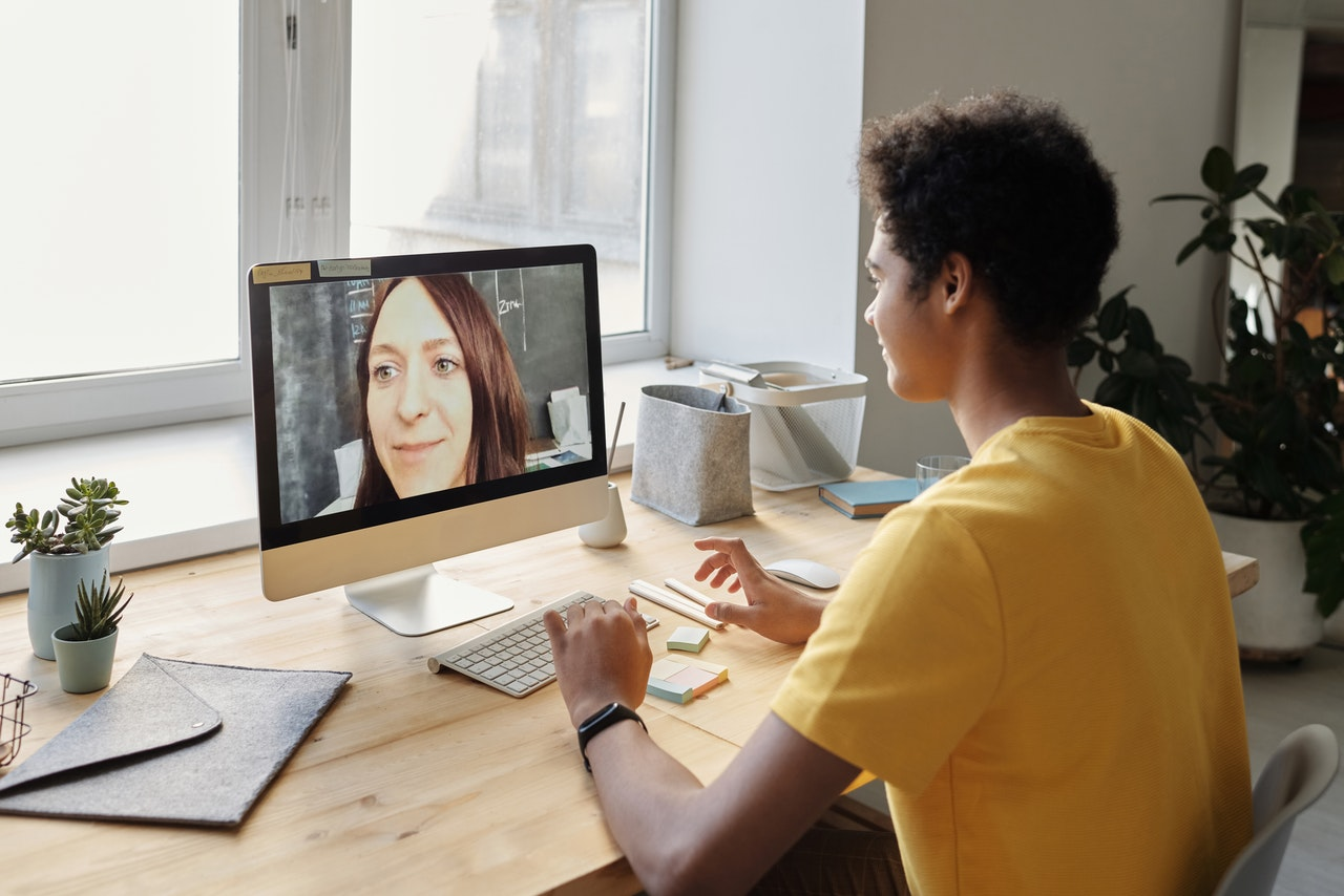 Student talking to an instructor in a video call
