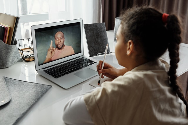 Student talking to a teacher in a video call